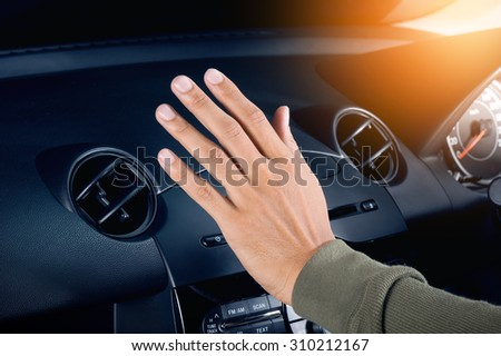 checking the air from air ventilation in the car - stock photo