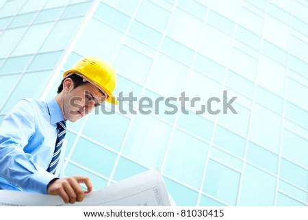 Checking the plan - stock photo