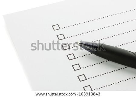 Checklist and pen closeup - stock photo