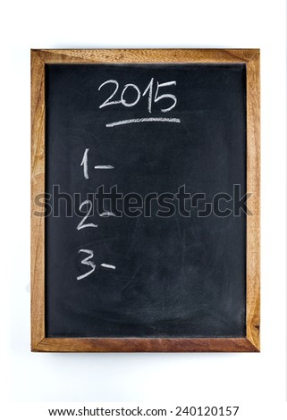 Checklist of three New Year purposes written with a chalk on a whiteboard. - stock photo
