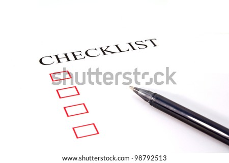 Checklist with pen and checked boxes. - stock photo