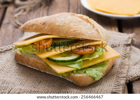 Cheddar Cheese Sandwich (detailed close-up shot) on wooden background - stock photo