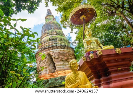Chedi at temple located on the edge of the jungle in Chiang Mai, Thailand - stock photo