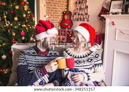 Cheer to that my love! Couple enjoying mulled wine, Christmas time - stock photo