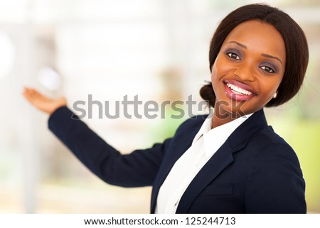 cheerful african american businesswoman presenting - stock photo