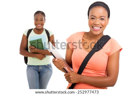cheerful african american college student holding laptop on white background - stock photo