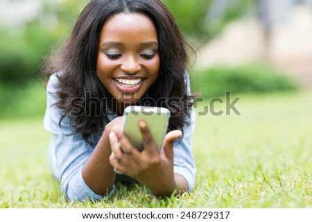 cheerful african american woman using smart phone - stock photo