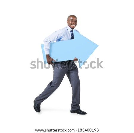 Cheerful African Businessman Holding an Arrow Sign - stock photo