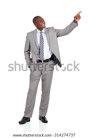 cheerful african businessman pointing at empty copy space - stock photo