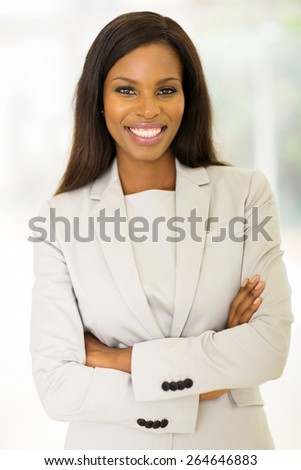 cheerful african entrepreneur with arms crossed - stock photo