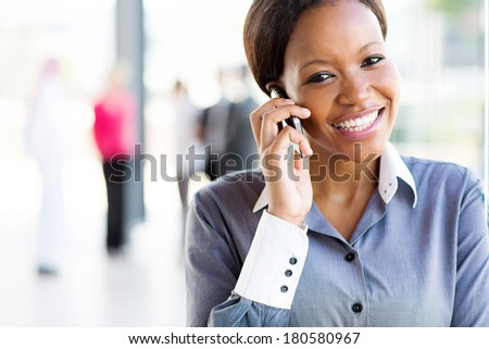 cheerful afro american businesswoman talking on cell phone - stock photo