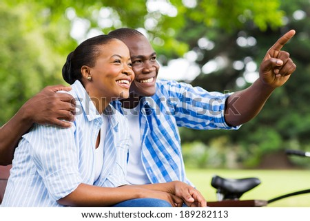 cheerful afro american couple relaxing outdoors - stock photo