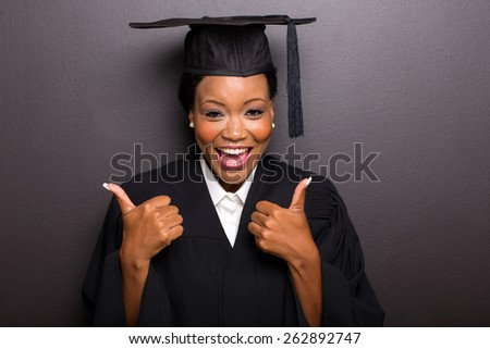 cheerful afro american female college graduate thumbs up - stock photo