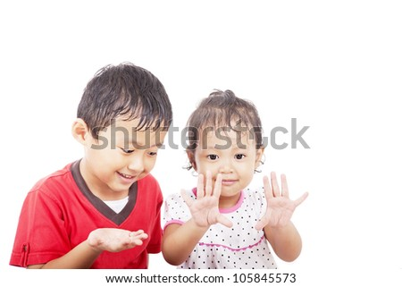 Cheerful asian siblings learning to count, shot in studio isolated on white - stock photo