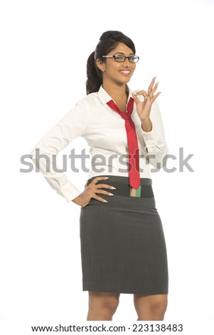 Cheerful attractive Indian businesswoman on white background. - stock photo