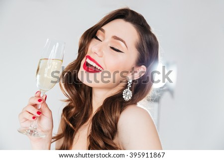 Cheerful attractive woman holding glass with champagne  - stock photo
