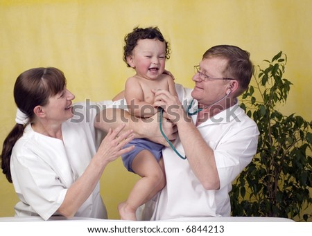 Cheerful baby at the doctcor. - stock photo