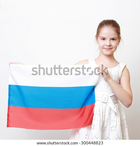 Cheerful beautiful little girl holding national flag of Russian Federation (Russia) - stock photo