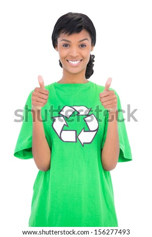 Cheerful black haired ecologist giving thumbs up on white background - stock photo