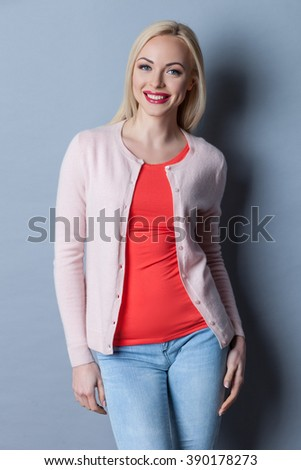 Cheerful blond girl is expressing positive emotions - stock photo