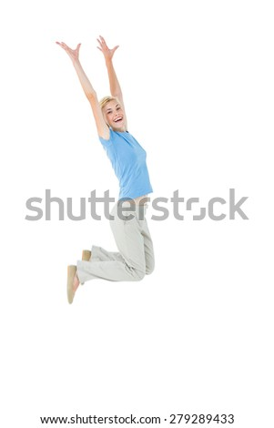 Cheerful blonde woman jumping on white background - stock photo