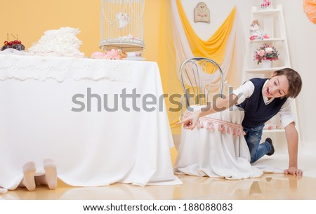 Cheerful boy found his sister in hide-and-seek - stock photo