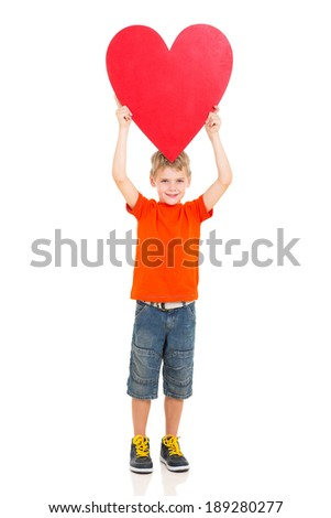 cheerful boy holding up red heart shape on white background - stock photo