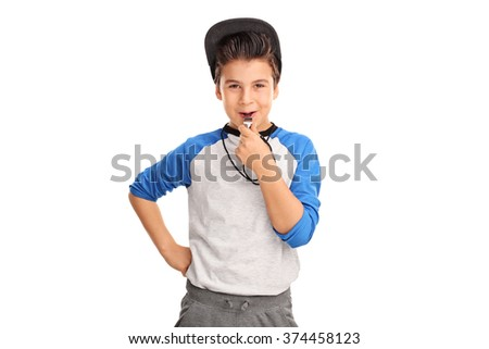 Cheerful boy in sportswear blowing a whistle and looking at the camera isolated on white background - stock photo