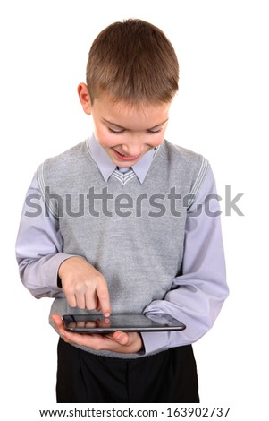 Cheerful Boy using Tablet Computer Isolated on the White Background - stock photo