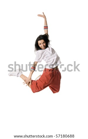 Cheerful breakdancer leaping high on white background - stock photo