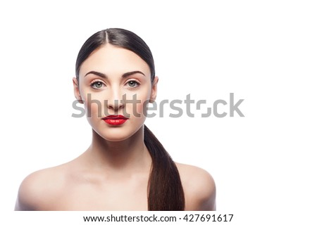 Cheerful brunette girl caring of her appearance - stock photo