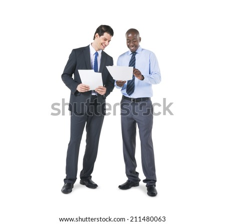 Cheerful Business Colleagues Discussing about the Documents - stock photo