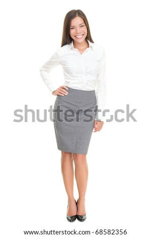 Cheerful business lady standing posing and laughing. Isolated on white background. - stock photo
