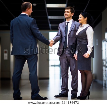 cheerful business men shaking hands - stock photo