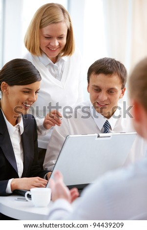 Cheerful business people discussing successful project - stock photo