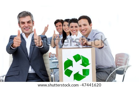 Cheerful business people showing the concept of recycling against a white background - stock photo