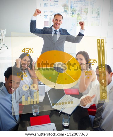 Cheerful business people using yellow pie chart interface in a meeting - stock photo