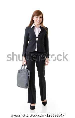 Cheerful business woman of Asian holding briefcase, full length portrait isolated on white background. - stock photo