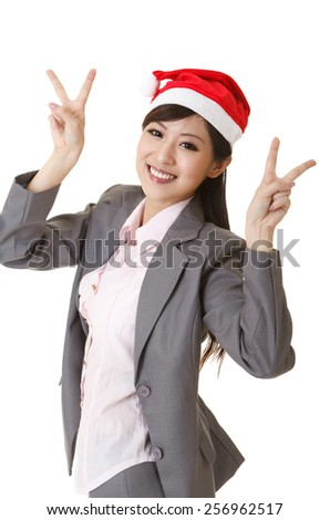 Cheerful business woman wearing Christmas hat, closeup portrait on white background. - stock photo