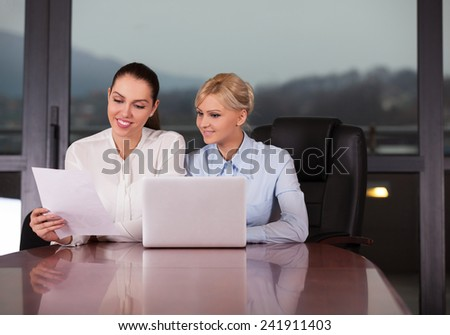 cheerful business women working in office - stock photo