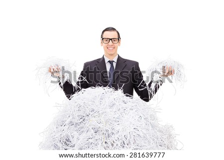 Cheerful businessman holding shredded paper in both hands and smiling isolated on white background - stock photo
