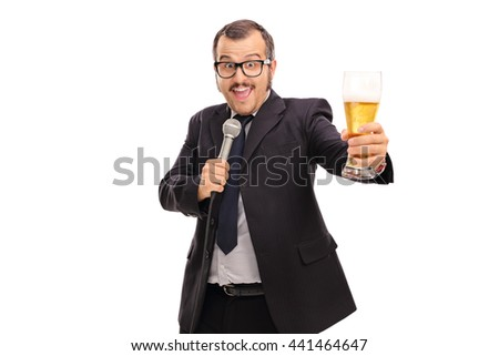 Cheerful businessman singing karaoke on microphone and holding a pint of beer isolated on white background - stock photo