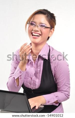 Cheerful businesswoman at work - stock photo