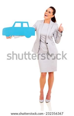 cheerful businesswoman holding blue car symbol isolated on white background - stock photo