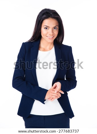 Cheerful businesswoman looking at camera. Standing over white background.  - stock photo