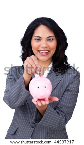 Cheerful businesswoman saving money in a piggybank isolated on a white background - stock photo