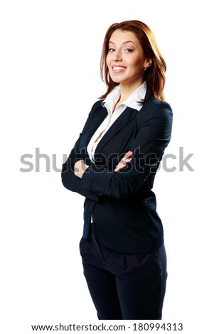 Cheerful businesswoman with arms folded looking away isolated on a white background - stock photo