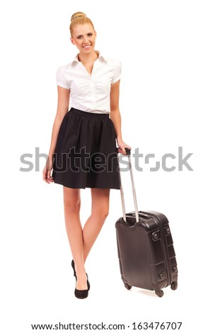 Cheerful businesswoman with black suitcase looking at camera. Full length studio shot isolated on white. - stock photo