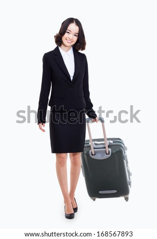 Cheerful businesswomen with travel bag isolated on white background.  - stock photo