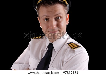 Cheerful captain in uniform on a black background - stock photo